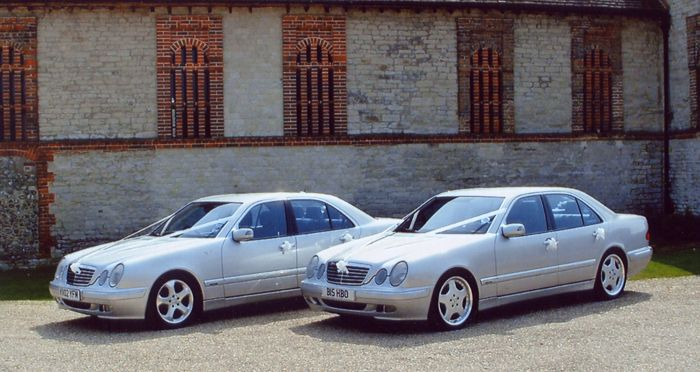 Mercedes E320 CDi. The one on the right is mine, at a wedding I did with a matching car.