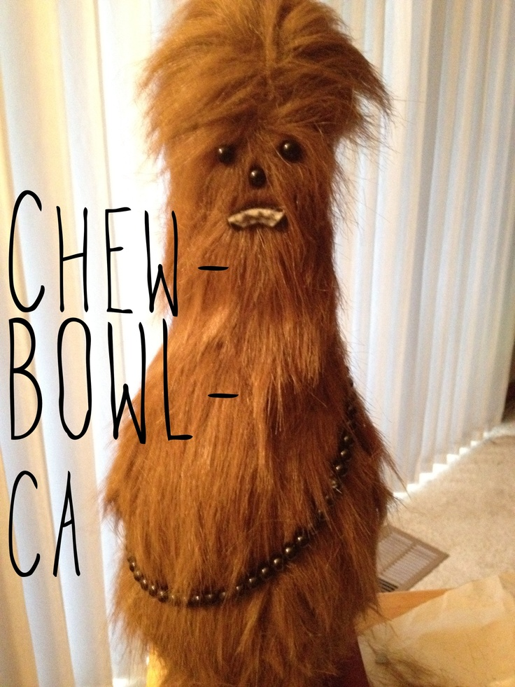 Chewbacca bowling pin! Craft fur for four dollars, some craft beads for the armory belt and face, and felt for the mouth! Honesty only cost a few bucks and 1.5 hours to make!