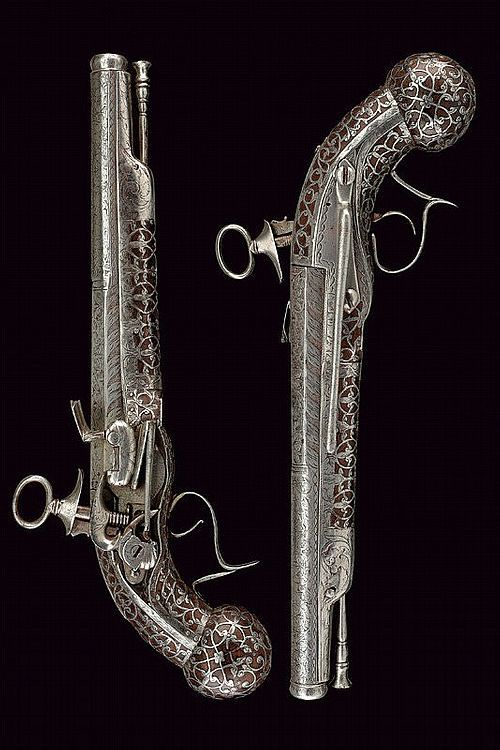 An exceptional pair of early Ripoll flintlock pistols by Armanguer - late 17th Century, Spain .
