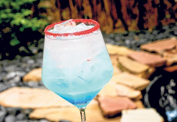 Cheers to America! This blue margarita with a red sugar rim is a fun detail for your next 4th of July celebration!