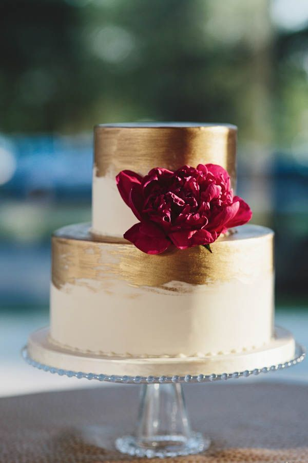 Chic gold brushed wedding cake with fuchsia flower - gorgeous! Photo by Sarah Culver Photography