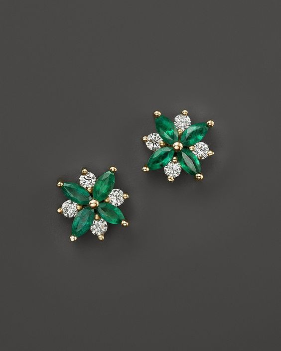 Emerald, diamond, and gold stud earrings