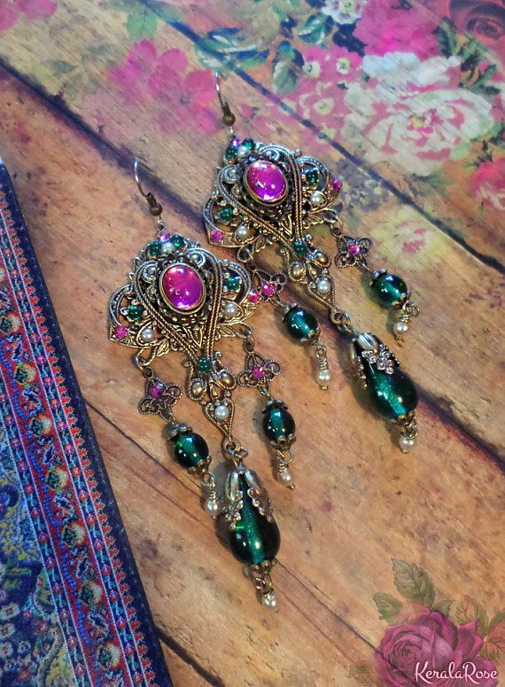 These Ornate Renaissance Gypsy Chandelier Earrings are made with intricate layered brass filigrees, hand-set glass stones in 3 royal shades and rich emerald glass beads. Available with Posts, Clip-Ons or French Wires. If french wires are chosen the top round stones will be omitted from the