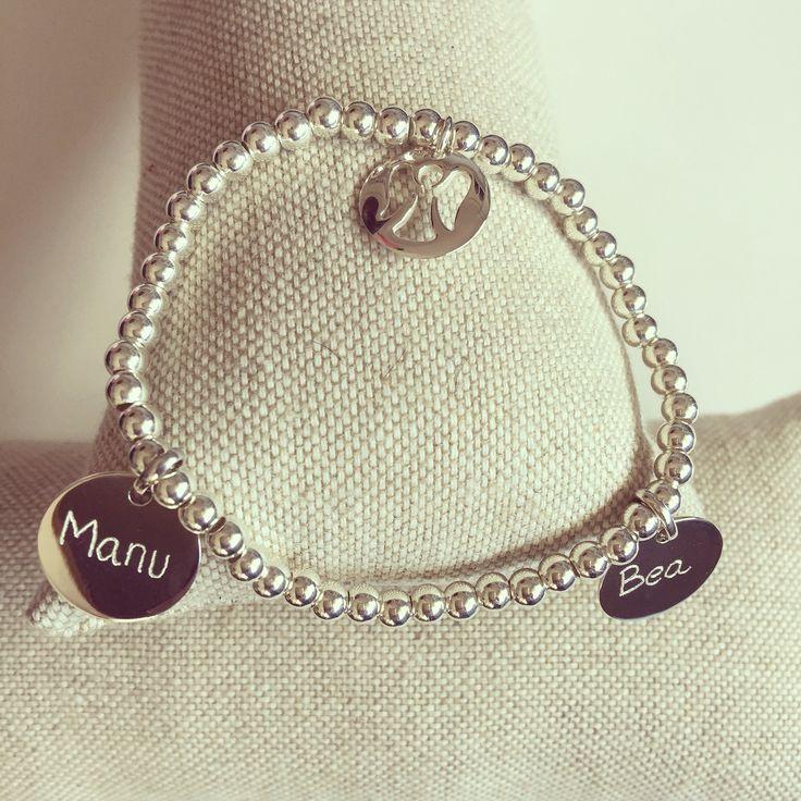 Custom silver bracelet with engraved names.