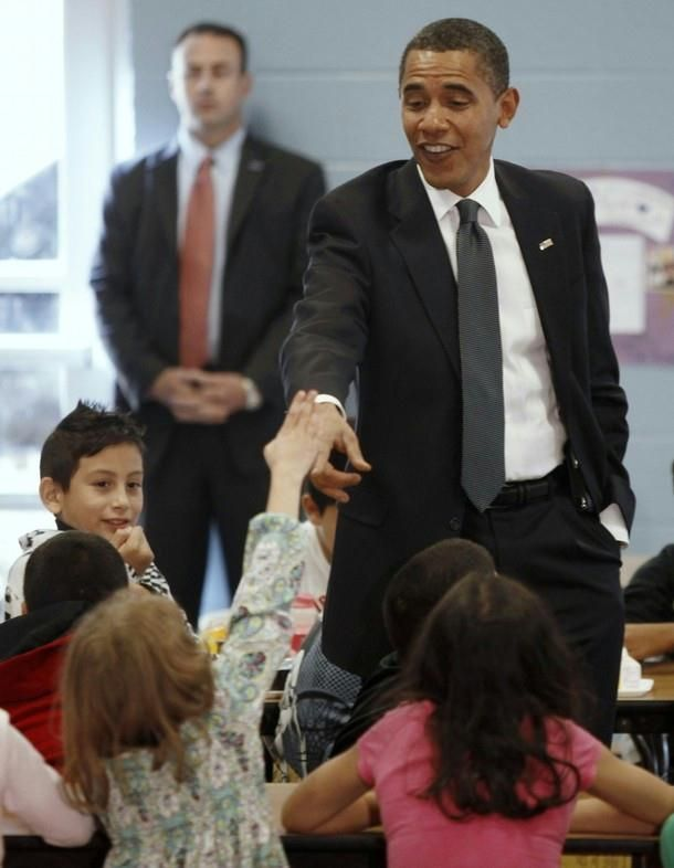 President Barack Obama chats with third and fourth grade students at Viers Mill Elementary School in Silver Spring, Maryland, October 19, 2009. Obama visited the school where the students had improved their standardized test scores.