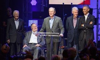 COLLEGE STATION, TX - OCTOBER 21:  (L-R) Former United States Presidents Jimmy Carter, George H.W. Bush, George W. Bush, Bill Clinton, and Barack Obama address the audience during the 'Deep from the Heart: The One America Appeal Concert' at Reed Arena on the campus of Texas A&M University on October 21, 2017 in College Station, Texas.  (Photo by Rick Kern/Getty Images for Ford Motor Company)