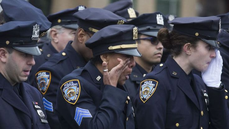 FBI chief Comey says at Liu's funeral that number of 2014 police deaths is 'shocking'