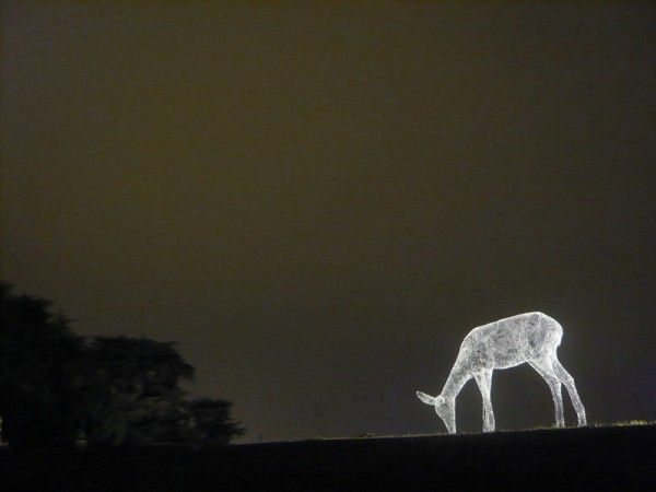 Paris-born artist Cedric Le Borgne creates these illuminated human figures (Les Voyageurs) and deer (La Biche) using delicately sculpted chicken wire. The figures are often installed in highly visible public places, suspended in the air in parks or in busy urban centers. Via his website: