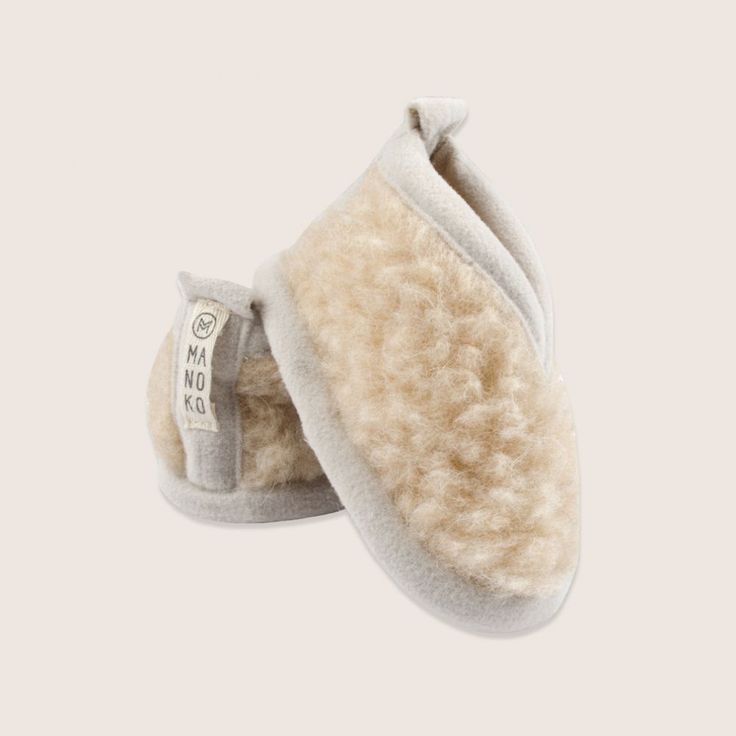 Super comfy beige slippers with brown sole by Manoko. Available online at Fancy Kids London