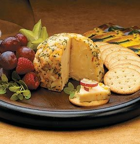 Cheese Ball - The belle of the ball, this party favourite rolls up aged cheddar and swiss cheeses with finely chopped red peppers and onions. Then it's covered with shredded marble cheddar cheese and flakes of parsley. Break out the crackers! Seasonal.