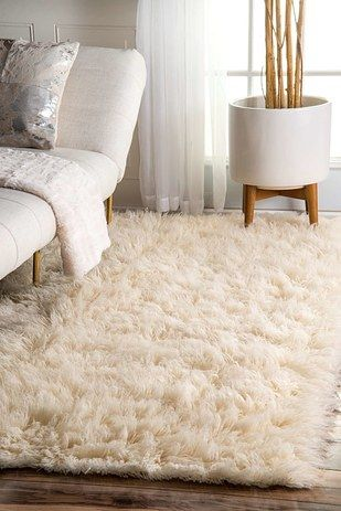 13 Cheap And Easy Ways To Take Your Bedroom To The Next Level - Add a furry rug next to your bed for extra ambiance.