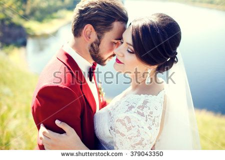 Bride and groom, lovely couple, wedding ceremony. Stylish man with mustache.