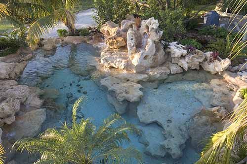 Swimming Pool with Natural Stone and Pool Remodels with Stone in Venice, Florida | Designed Outdoor Living