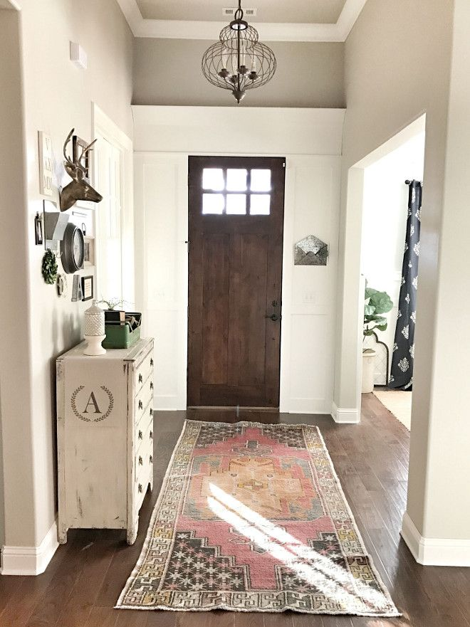 The Wall Paint Color Is Sherwin Williams Agreeable Gray. Trim Color Around  Front Door Is Sherwin Williams Snowbound.  Love Light Fixture Too.