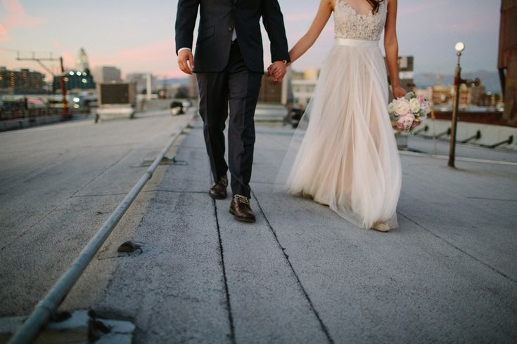 Bride in ivory tulle and lace, groom in black suit. LVL Weddings and Events // Venue: 440 Seaton // Photography: Shane and Lauren Photography // DJ: SoCal Mobile DJ // Hair and Make Up: Mimica Blasco // Photobooth: Photo Moto Media // Caterer: Max City BBQ // Lighting: Pacific Event Lighting // Piano Rental: Kim's Piano // Rentals: Imperial Party Rentals // Florist: In Flower Design // Security: Sandman Security // Bridal Gown: Watters