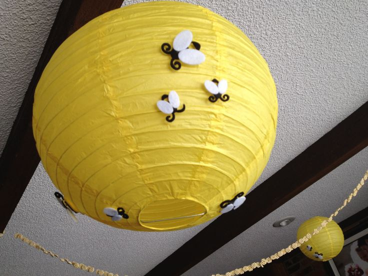 Pooh hives - paper lanterns with felt bees hanging from the ceiling