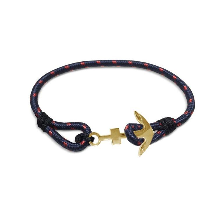 Frank 1967 7FB-0078 - Rope armband Stalen anker van 15 mm, lengte 22 cm. Donkerblauw, rood, goudkleurig. Deze hippe gewoven rope armband is van Frank 1967. De armband komt in het donkerblauw en heeft rode stippen. De dikte is 3 mm. Verkrijgbaar met een goud- of rosékleurige anker van 2,5 cm breed en 1,5 cm lang. Voorzien van een lus sluiting. Ideaal om te combineren met andere rope armbanden van Frank 1967!
