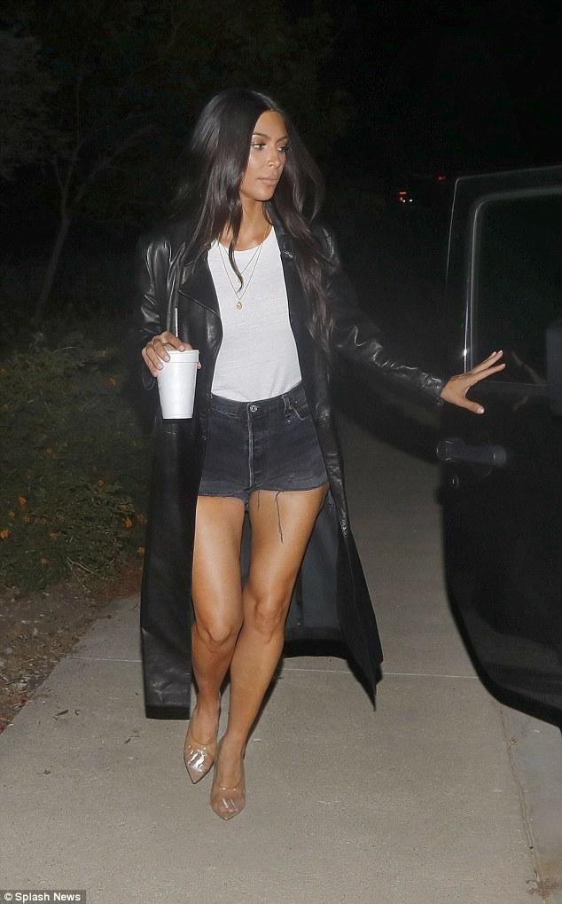 Kim Kardashian wearing Yeezy Mule PVC Clear and American Apparel Eco-Jersey Crew T-Shirt
