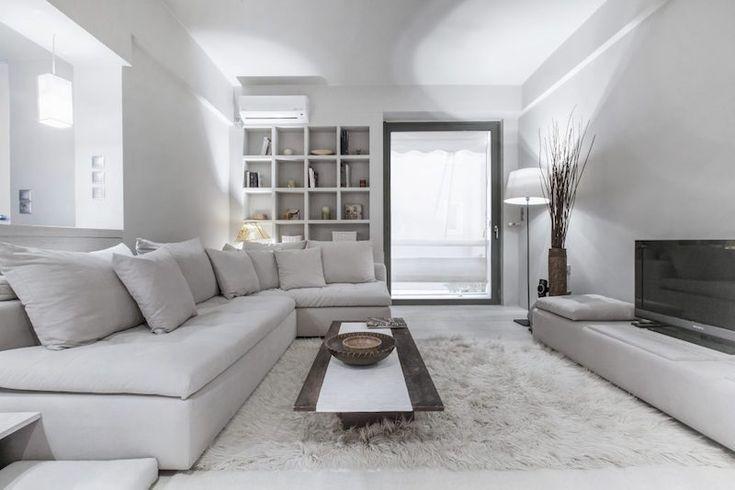canapé d'angle et peinture gris perle dans un studio design par AD architects