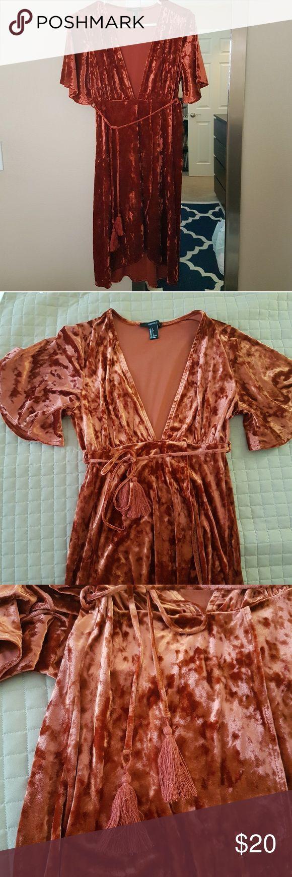 NWOT Crushed Velvet Plunging Midi Dress NWOT.  Crushed Velvet Plunging Midi Dress.  Color is an almost burnt orange-red. Tulip style bottom skirt part of the dress, has a tassel waist tie.  90% Polyester, 10% Spandex. Forever 21 Dresses High Low