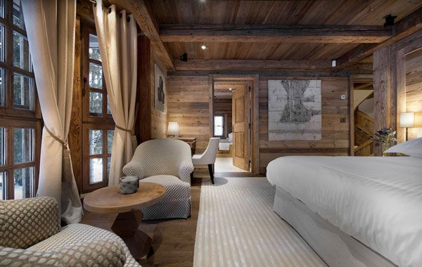 Such a peaceful room. Love the wood on the walls and ceilings. So elegant and tranquil. Would love to lay on the bed and watch the snow fall there.
