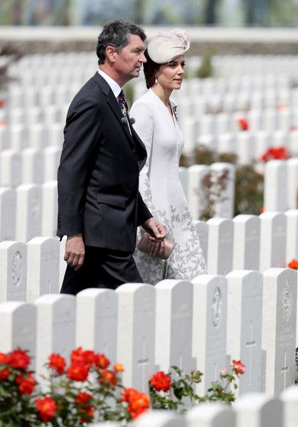 Kate Middleton Photos Photos - Vice Admiral Sir Timothy Laurence and Catherine, Duchess of Cambridge walk through the Commonwealth War Graves Commisions's Tyne Cot Cemetery ahead of a ceremony on July 31, 2017 in Ypres, Belgium. The commemorations mark the centenary of Passchendaele - The Third Battle of Ypres. - Members Of The Royal Family Attend The Passchendaele Commemorations In Belgium