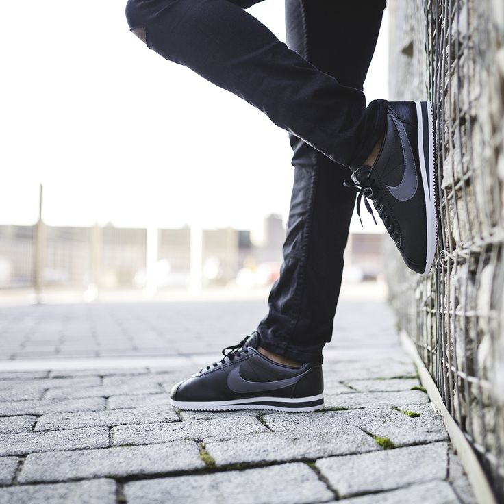 huge discount d7e49 05443 ... Go retro with the Nike Cortez Leather Trainer in black dark grey. ...