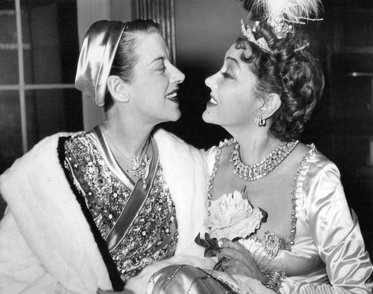 Beatrice Lillie and Gloria Swanson enjoying the Knickerbocker Ball at the Waldorf-Astoria Hotel for the benefit of the Korean War Wounded Fund. December, 1951