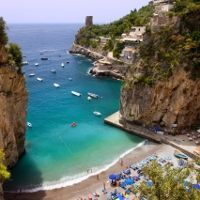 Marini di Praia is a pebble beach located at the foot of a cliff on the Amalfi Coast and home to several restaurants and even one of the most fashionable dance clubs in the world. But it's the bright blue umbrellas and water that earns it a spot on this list.