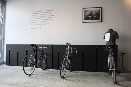 A place to park the bikes | This is very nice. More offices need places to store bikes, safe from the rain.