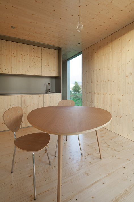 MIMA's modular construction combines #lightness and #minimalism and seems to levitate due to its mirrored base Images © José Campos #timber #kitchen