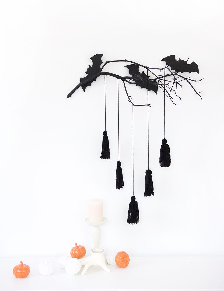 give your spooky decor a mod makeover with this easy to make modern halloween wall decor project using decoart outdoor living paint - Halloween Wall Decorations