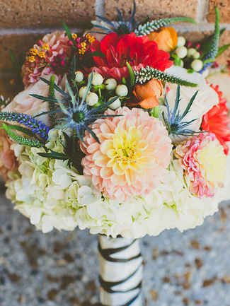 Add texture to your hydrangea wedding bouquet with dahlias, veronica and thistle for an element of surprise.
