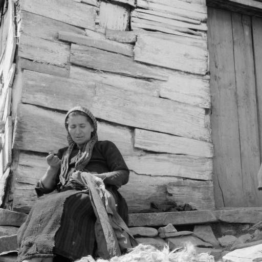 Greece, women sorting wool fur and sewing outside home in Métsovon