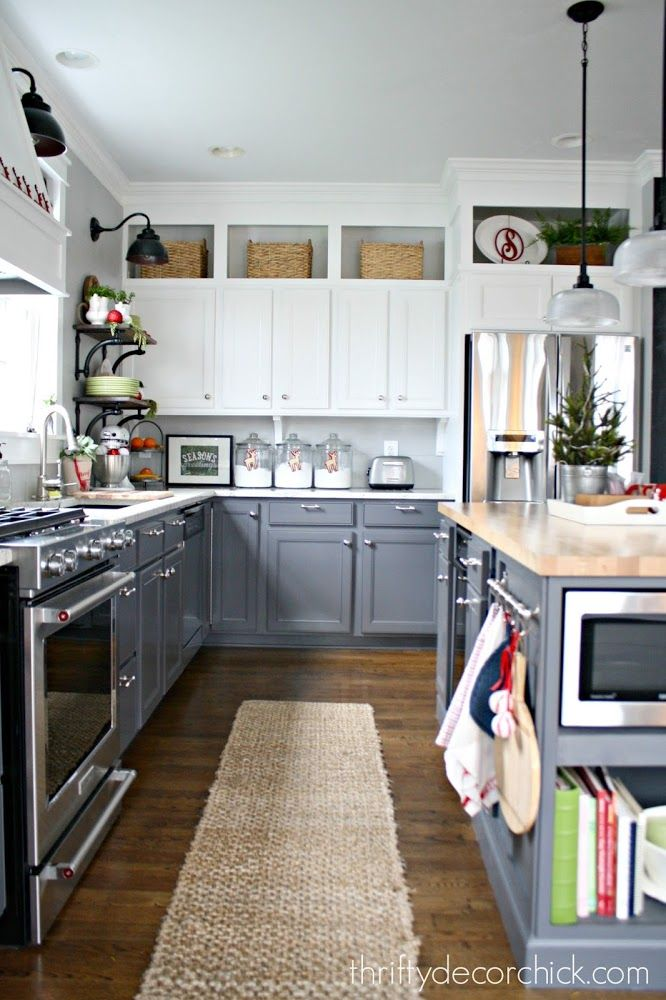 two toned kitchen - baskets above kitchen cabinets