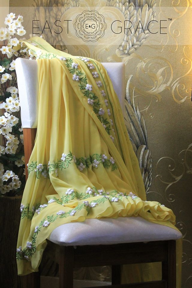 White Buttercup - White satin #ribbonwork on pastel yellow pure georgette #saree #eastandgrace #indian. E&G is coming soon: www.eastandgrace.com