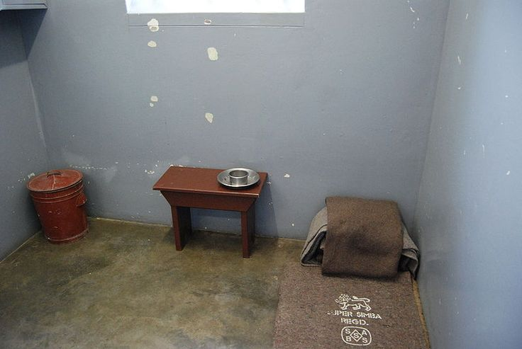 Nelson Mandela's tiny cell on Robben Island, where he lived 18/27 years of imprisonment.