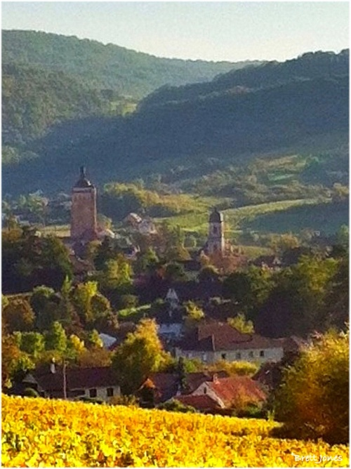 Arbois afternoon.  The church tower of St Just dominates the Jura town of Arbois. A view from the recently harvested vineyards beneath la Tour de Couron.  The Wine Maestro's photo blog