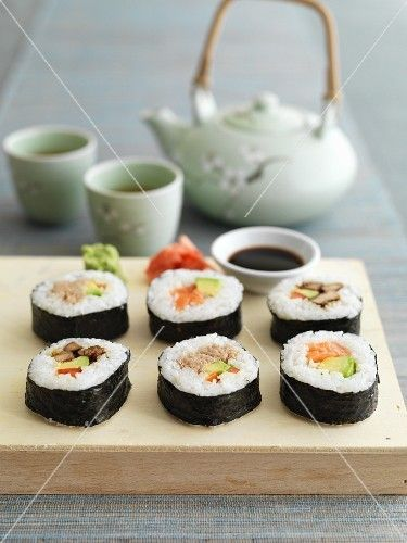 Maki sushi with ginger, wasabi, soy sauce and tea