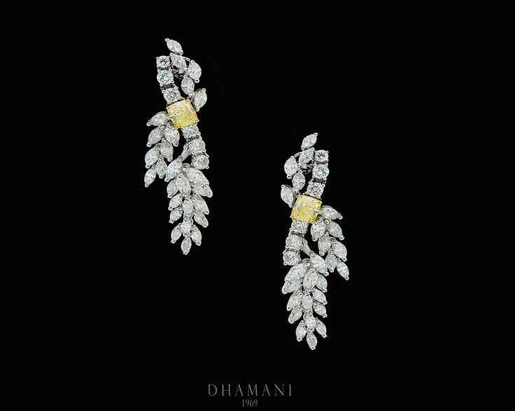 A dazzling combination of a #Diamond #Earring with 18k White & Yellow Gold Weighing 4.08 Grams, Studded with 2.02 Carats Natural Fancy Light Yellow #Diamonds and 0.38 Carats of Natural Round #Diamonds - AT Dhamani The Dubai Mall #Dhamani1969 #luxury #gifts #Engagement #Wedding
