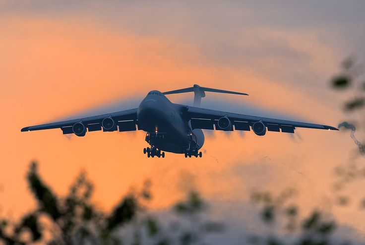 "youlikeairplanestoo: "" The C-5 Galaxy's massive wing sure does make some impressive condensation! Would've loved to have been there to see this one coming in. Photo by Karl-HeinzK. Used with..."