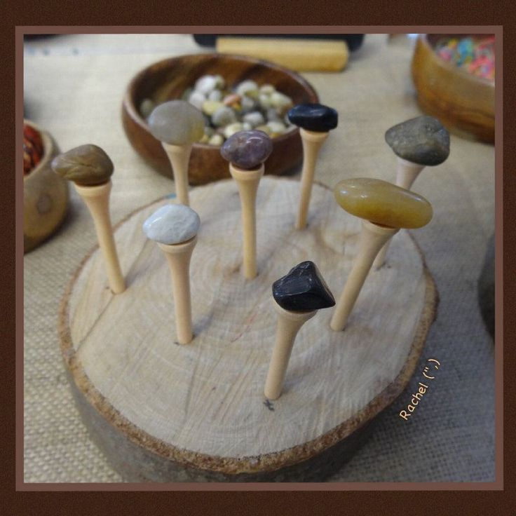 "Golf tees in a wood slice from Rachel ("",)"