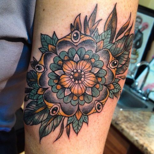 Like the neo traditional flower but with brighter colors.              I actually love it with the pops of color