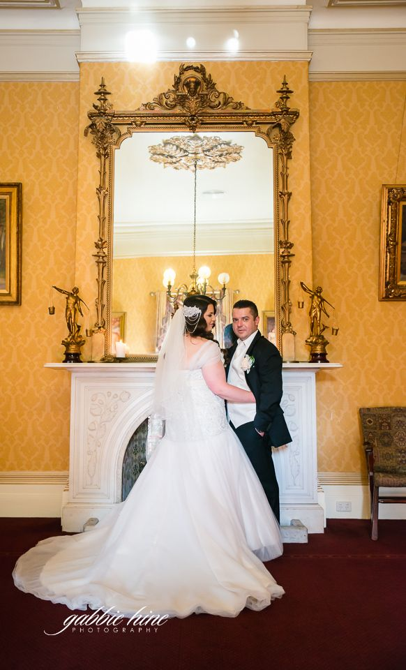 Wedding portraits in the music room at Ascot House receptions
