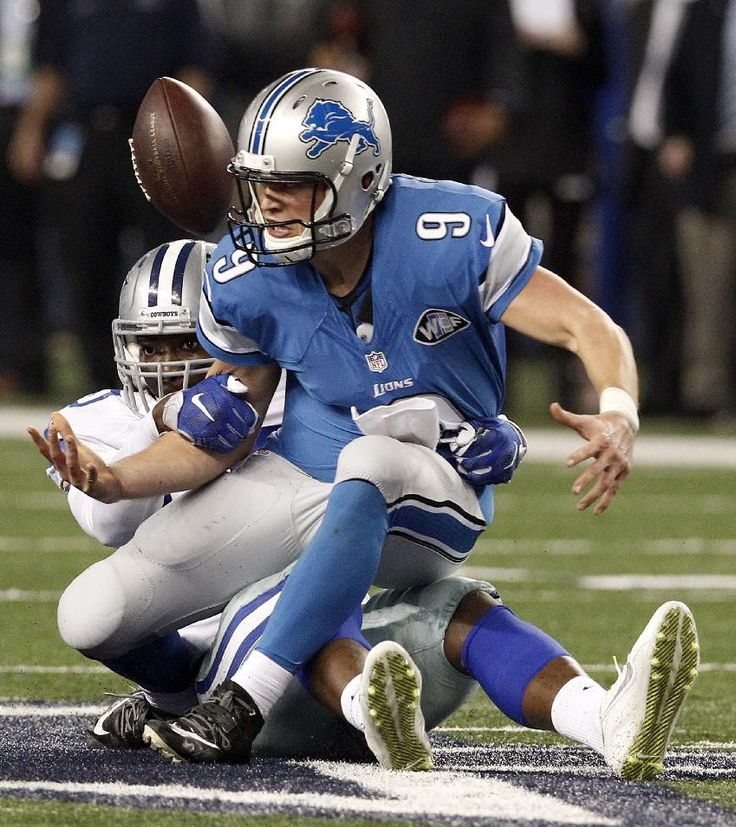 Dallas Cowboys defensive end Demarcus Lawrence (90) sacks Detroit Lions quarterback Matthew Stafford (9) cause a fumble during the second half of an NFL wildcard playoff football game, Sunday, Jan. 4, 2015, in Arlington, Texas. The Cowboys won 24-20. (AP Photo/Brandon Wade)