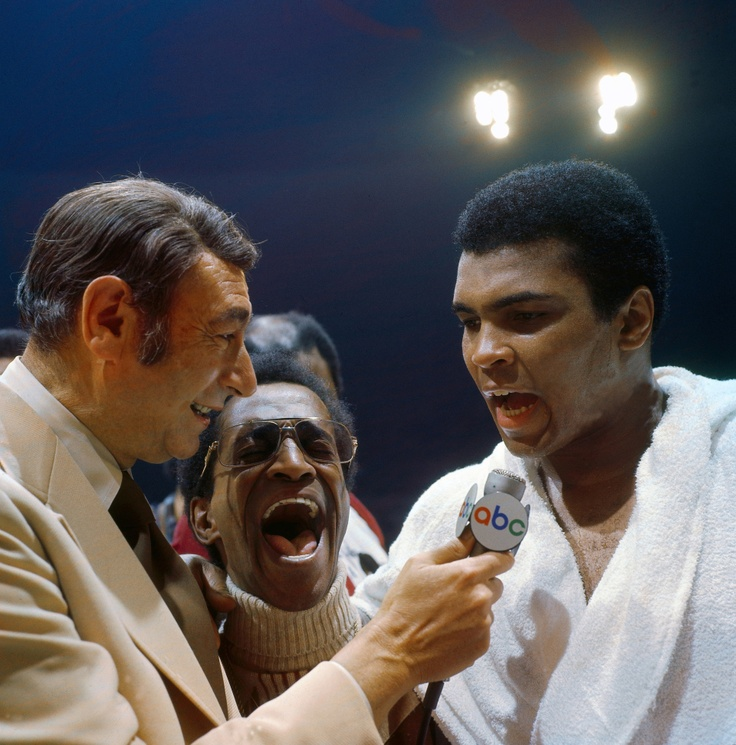 Muhammad Ali talks to ABC Sports announcer Howard Cosell as Sammy Davis Jr. laughs during the post-fight interview after winning a fight versus Joe Bugner at the Las Vegas Convention Center.  Las Vegas, Nevada 2/14/1973
