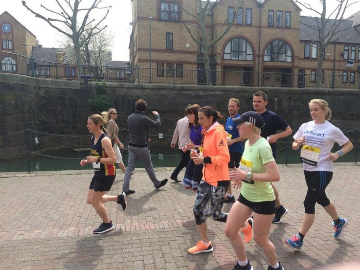 Jo Pavey chats with The Running Works guests during a run to Shadwell Basin, London