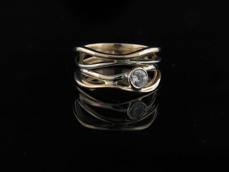 Two tone diamond wavy ring with bezel set diamond.