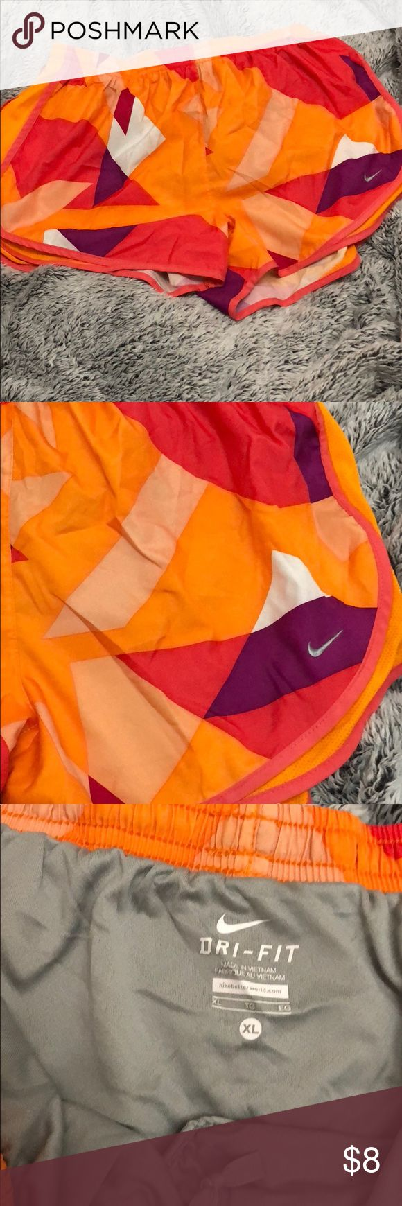 Multicolor Nike women's shorts Orange, purple, pink and white women's Nike shorts Only worn once! Dri-fit Size XL Nike Shorts