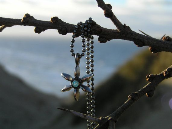 Propeller pendant in sterling silver with blue topas. Made by Loenstrup Smykke Design - Nynne Kegel - Lønstrup